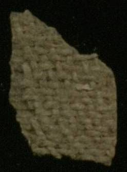 Cartonnage fragment constructed from linen.  This image shows the linen backing of the gesso outer layer.